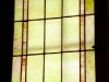 Pivoting stained glass window