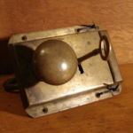 Brass railroad lock with ring pull and key (side 1) 201-5687-1-1-1